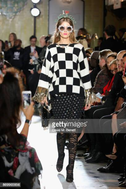 Mila Miletic walks the Dolce Gabbana Italian Christmas catwalk show at Harrods on November 2 2017 in London England