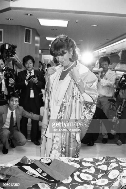 Mila Mulroney wife of Canadian Prime Minister Brian Mulroney tries Japanese kimono during her visit to the Takashimaya Department Store on the...