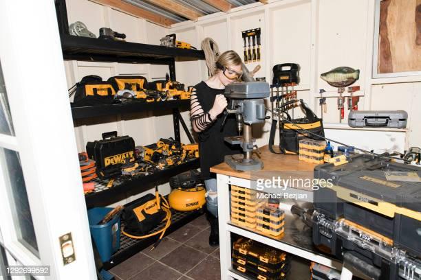 "Mila Nabours in Dewalt Workshop drilling TAP ""First Break"" Medallion at Conejo and Friends Visit TAP Studios on December 21, 2020 in Los Angeles,..."