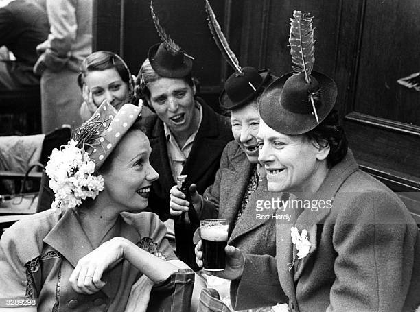Mila Parely the film actress having a chat and a giggle with some friends who are on a day trip during a visit to Southend Original Publication...