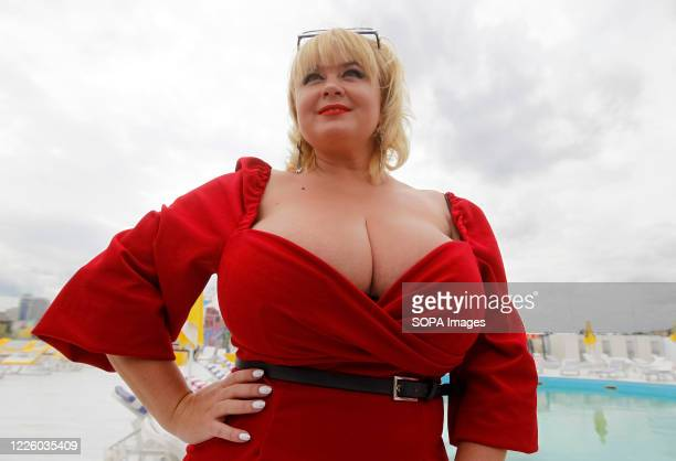 Mila poses for photos during the event. National Register of Records of Ukraine registered Ukrainian model, Mila Kuznetsova with the largest natural...