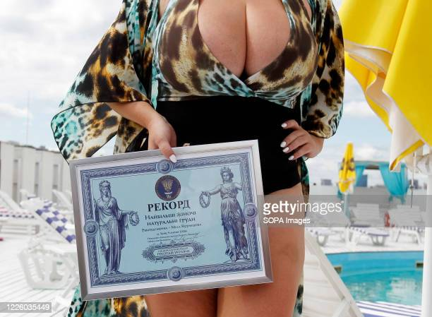 Mila shows her record certificate during the event National Register of Records of Ukraine registered Ukrainian model Mila Kuznetsova with the...