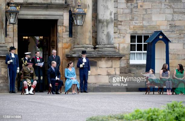 Mila Sneddon with her sister Jodi, and mother Lynda waves to the Duke and Duchess of Cambridge, during the Beating of the Retreat at the Palace of...