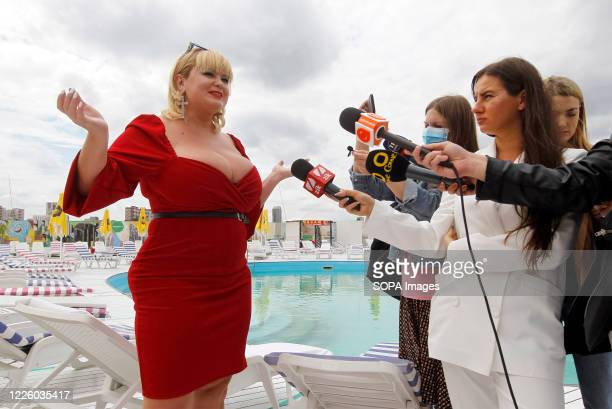 Mila speaking to journalists during the event. National Register of Records of Ukraine registered Ukrainian model, Mila Kuznetsova with the largest...