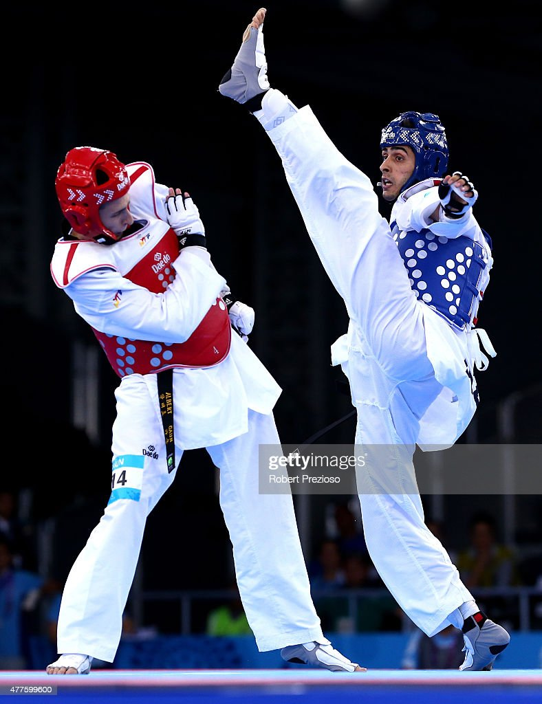 Milad Beigi Harchegani of Azerbaijan and Albert Gaun of Russia compete in the Men's Taekwondo -80kg final on day six of the Baku 2015 European Games at the Crystal Hall on June 18, 2015 in Baku, Azerbaijan.