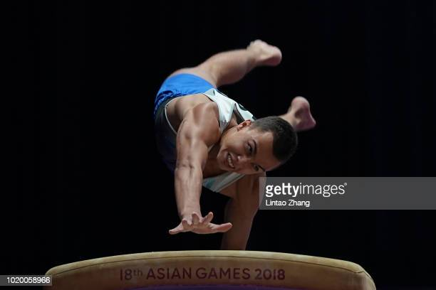 Milad Karimi of Kazakstan competes on the Pommel Horse in qualification one of the artistic gymnastics event on day two of the Asian Games on August...