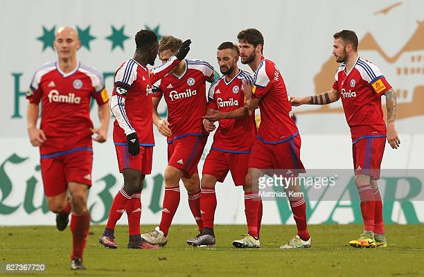 Milad Salem of Kiel celebrates with team mates after scoring the fived goal during the third league match between FC Hansa Rostock and Holstein Kiel...