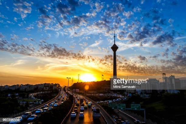milad tower and street at sunset, tehran, iran - tehran stock pictures, royalty-free photos & images