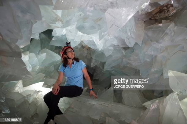 Milagros Carretero coordinating geologist of the giant geode of Pilar de Jaravia in Pulpi sits inside the geode on August 2 2019 The geode of Pulpi...