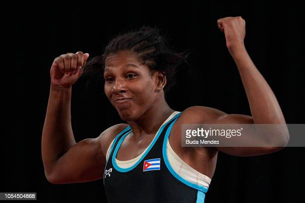 Milaimys de la Caridad Marin Potrille of Cuba celebrates after winning in Women's Freestyle 73kg Gold Medal Match during day 7 of Buenos Aires Youth...