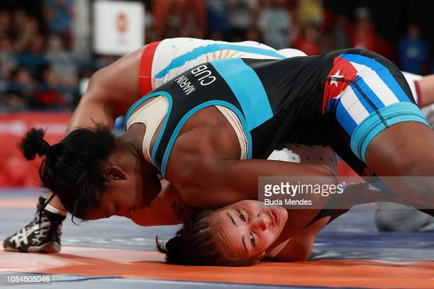 Milaimys de la Caridad Marin Potrille of Cuba fights against Linda Marilina Machuca of Argentina in Women's Freestyle 73kg Gold Medal Match during...