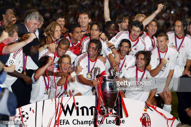 Milan AC players jubilate after winning the European Champions League Final Match against Juventus at Old Trafford Stadium 28 May 2003 in Manchester...