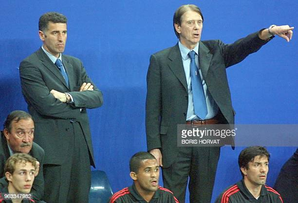 Milan AC's new trainer Cesare Maldini flanked by assistant Mauro Tassotti coaches his team 21 March 2001 during Marseille's indoor soccer tournament...
