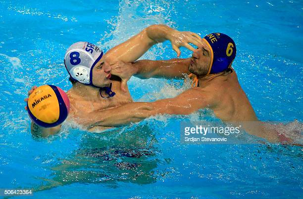 Milan Aleksic of Serbia is challenged by Aleksandar Radovic of Montenegro during the Men's Gold Medal match between Serbia and Montenegro at the...