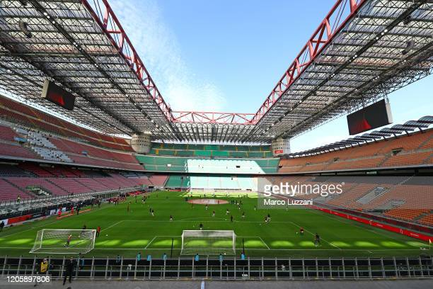 Milan and Genoa CFC players warm up in the empty stadium after rules to limit the spread of Covid19 have been put in place before the Serie A match...