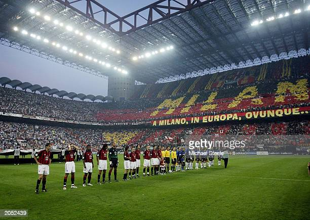 Milan and Inter Milan players line-up in front of an amazing atmosphere before the UEFA Champions League Semi-Final First Leg match between AC Milan...