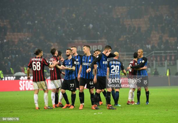 AC Milan and Inter Milan's players shake hands at the end of the Italian Serie A football match AC Milan vs Inter Milan at the San Siro stadium in...