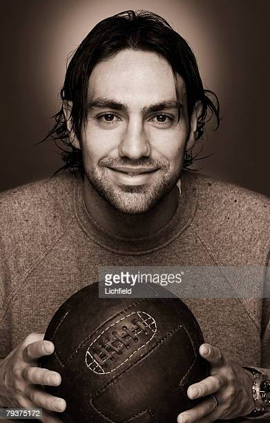 AC Milan and Italy centre back Alessandro Nesta holding an old fashioned leather football 23rd October 2003