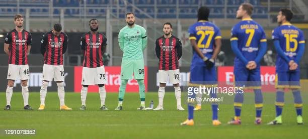 Milan and Parma Calcio players participate in a minute silence in memory of the deceased Italian former player Paolo Rossi prior to the Serie A match...