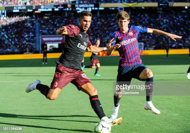 Milan Andre Silva holds off a FC Barcelona player as he tries to score during the International Champions Cup match between AC Milan and FC Barcelona...
