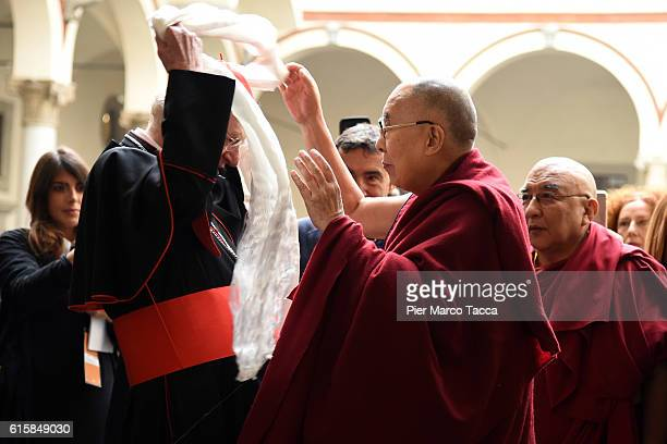 Milan Archibishop Angelo Scola welcomes Dalai Lama during a meeting with the Archbishop on October 20 2016 in Milan Italy The Dalai Lama spiritual...