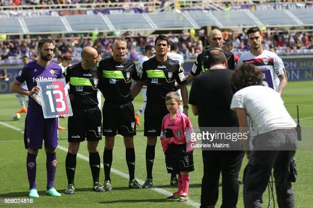 Milan Badelj captain of ACF Fiorentina and Luca Ceppitelli captain of Cagliari Calcio exchange the shirt of Davide Astori during the serie A match...