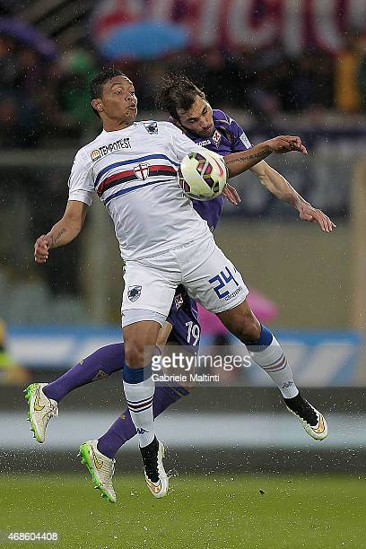 Milan Badelj of ACF Fiorentina battles for the ball with Luis Muriel of UC Sampdoria during the Serie A match between ACF Fiorentina and UC Sampdoria...