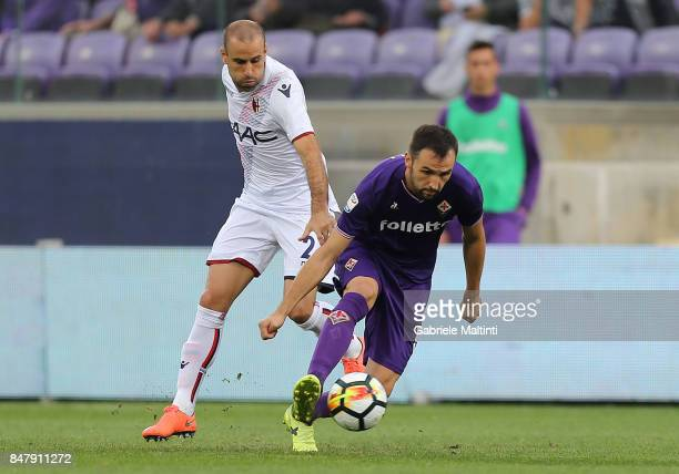 Milan Badelj of ACF Fiorentina battles for the ball with Rodrigo Palacio of Bologna FC during the Serie A match between ACF Fiorentina and Bologna FC...