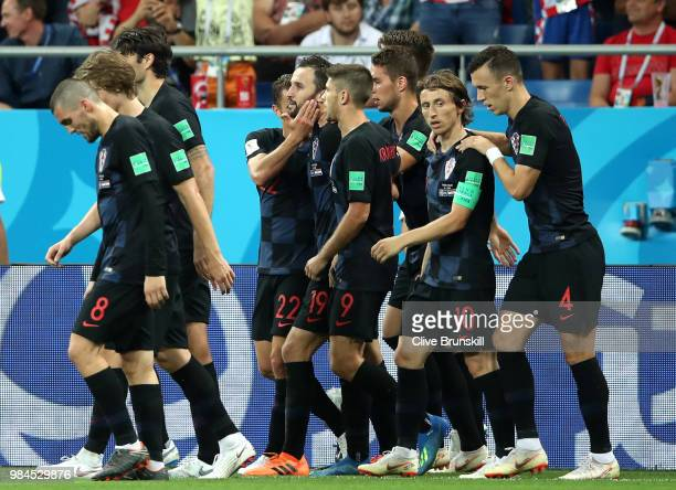 Milan Badelj of Croatia celebrates with teammates after scoring his team's first goal during the 2018 FIFA World Cup Russia group D match between...