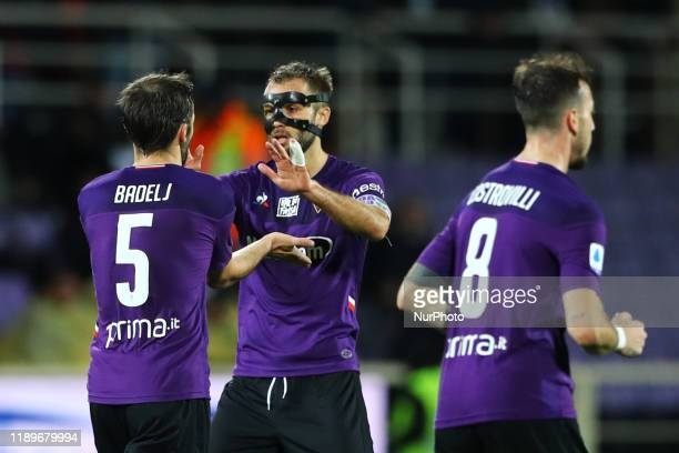 Milan Badelj of Fiorentina celebrates with German Pezzella of Fiorentina during the football Serie A match Ac Fiorentina v AS Roma at the Artemio...