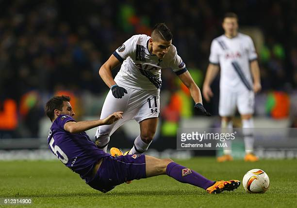 Milan Badelj of Fiorentina pulls on the shorts of Erik Lamela of Tottenham Hotspur as he makes a tackle during the UEFA Europa League match between...