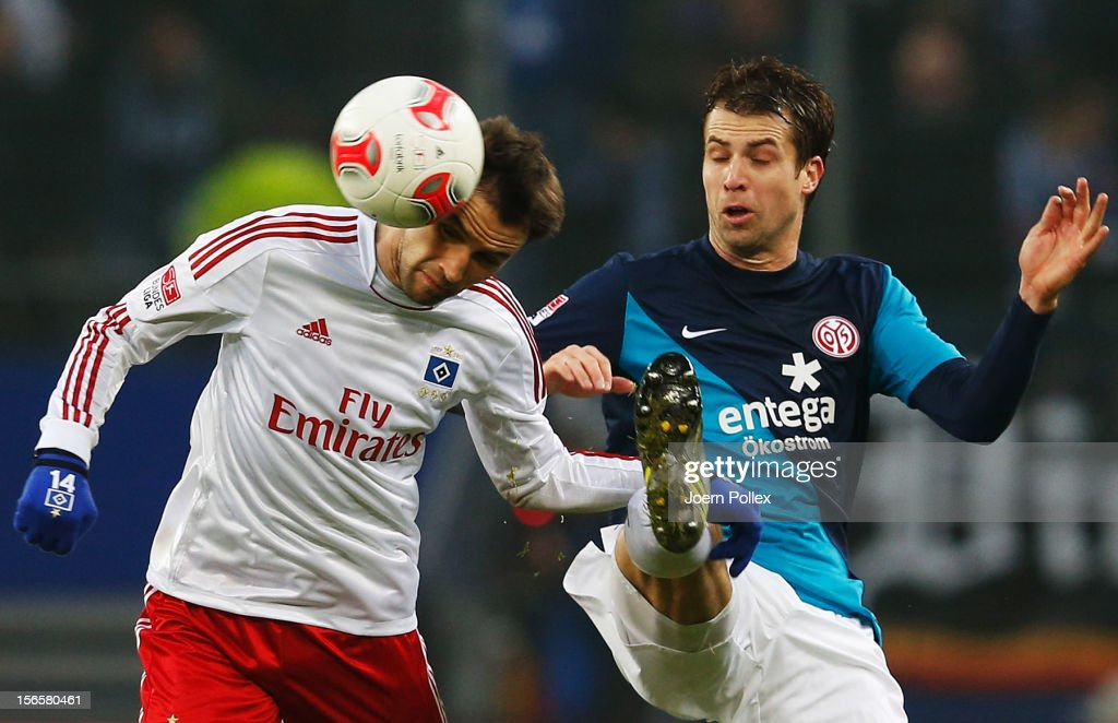 Milan Badelj (L) of Hamburg and Andreas Ivanschitz of Mainz compete for the ball during the Bundesliga match between Hamburger SV and 1. FSV Mainz 05 at Imtech Arena on November 17, 2012 in Hamburg, Germany.