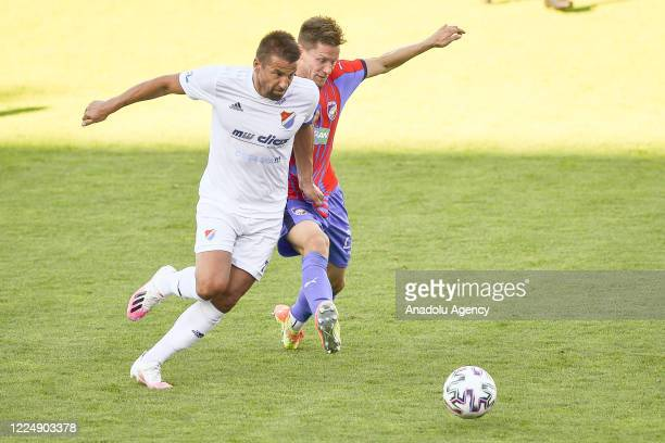 Milan Baros of Banik Ostrava in action against Lukas Hajda of Viktoria Plzen during the Fortuna League soccer match between FC Banik Ostrava and FC...