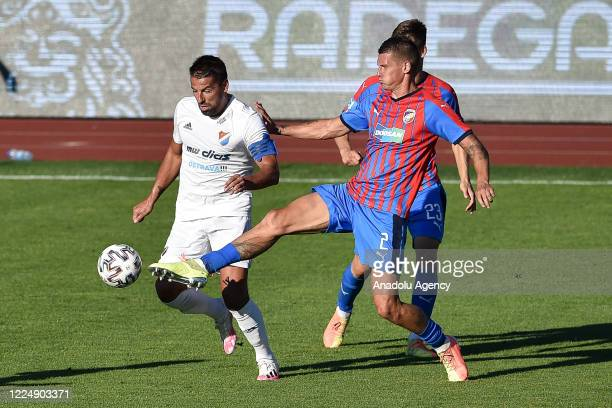 Milan Baros of Banik Ostrava in action against Lukas Hejda of Viktoria Plzen during the Fortuna League soccer match between FC Banik Ostrava and FC...