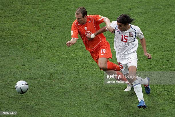 Milan Baros of Czech battles with Arjen Robben of Holland during the UEFA Euro 2004 Group D match between Holland and the Czech Rep at the Municiple...