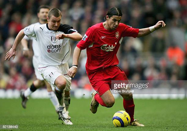 Milan Baros of Liverpool attempts to move away from Lee Clark of Fulham during the Barclays Premiership match between Liverpool and Fulham at Anfield...