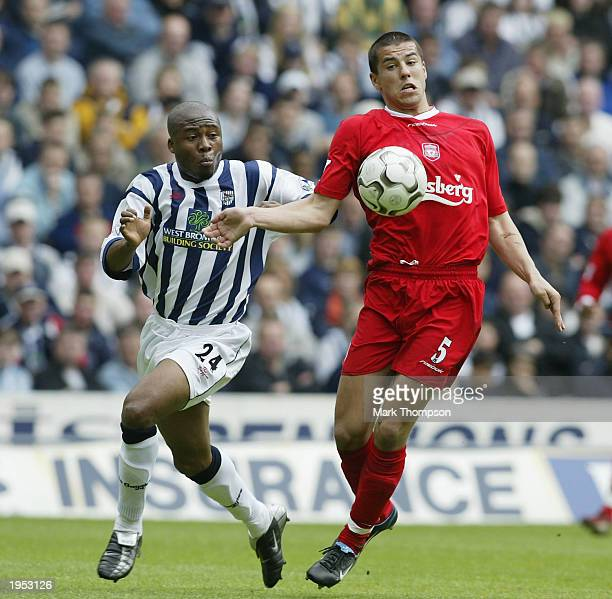 Milan Baros of Liverpool avoids Ifeanyi Udeze of West Bromwich Albion during the FA Barclaycard Premiership match between West Bromwich Albion and...