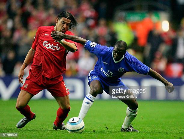 Milan Baros of Liverpool battles with Claude Makelele of Chelsea during the UEFA Champions League semifinal second leg match between Liverpool and...