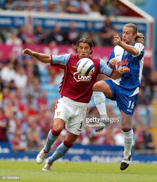 Milan Barros of Aston Villa battles with Tugay of Blackburn during the FA Barclays Premiership match between Aston Villa and Blackburn Rovers at...