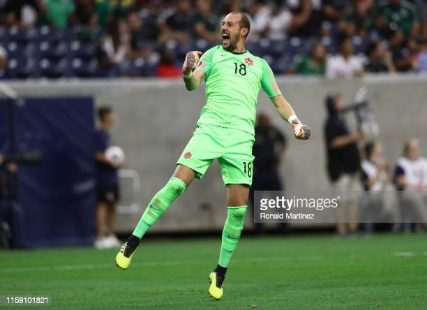 Milan Borjan of Canada celebrates a goal in the first half against Hait during the quarterfinals of the 2019 CONCACAF Gold Cup at NRG Stadium on June...