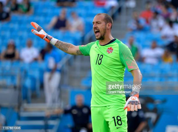 Milan Borjan of Canada sets his defense against Cuba during the first half of their Group A 2019 CONCACAF Gold Cup match at Bank of America Stadium...