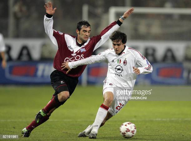 Milan Brazilian midfielder Kaka vies with Reggina defender Giuseppe Colucci in an Italian serie A football match at Granillo stadium in Reggio di...