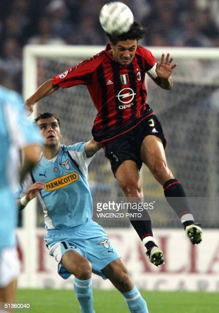 Milan captain Paolo Maldini jumps for the ball with Goran Pandev of AS Lazio in an Italian Serie A match at Olympic stadium in Rome 26 September 2004...
