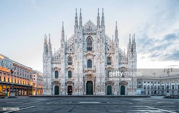 milan cathedral, duomo di milano at dawn - cathedral stock pictures, royalty-free photos & images