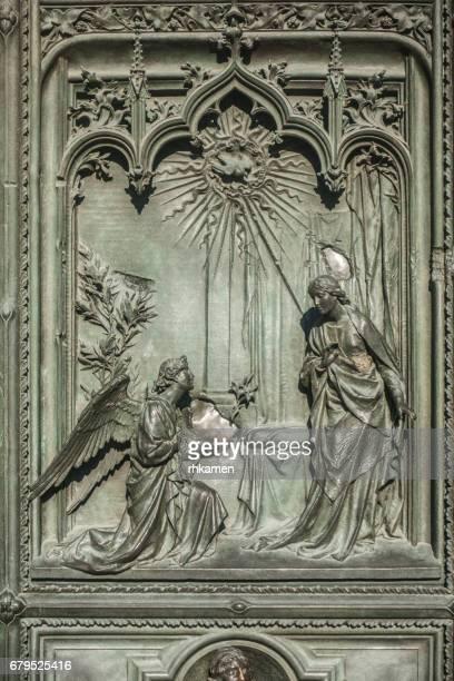 milan cathedral, duomo di milano, piazza del duomo. milan, italy. door. - annunciation stock pictures, royalty-free photos & images
