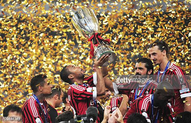 AC Milan celebrates their winning of the 2011 Italy Super Cup after the match against Inter Milan at National Stadium on August 6 2011 in Beijing...