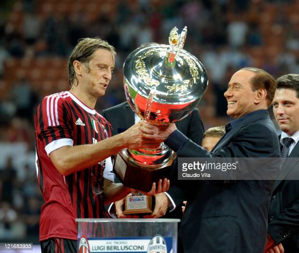 Milan chairman Silvio Berlusconi and Massimo Ambrosini celebrate after winning the Berlusconi Trophy during the Berlusconi Trophy match between AC...