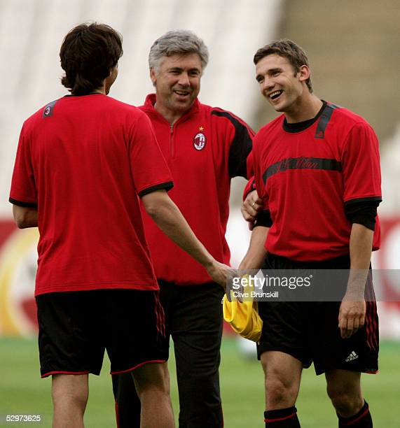Milan coach Carlo Ancelotti talks to AC Milan Striker Andriy Shevchenko of Ukraine and AC Milan Midfielder Kaka of Brazil as they warm up during a...