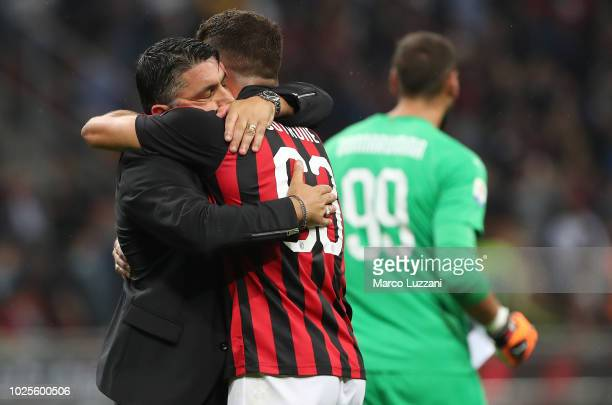 Milan coach Gennaro Gattuso celebrates a victory with Patrick Cutrone at the end of the serie A match between AC Milan and AS Roma at Stadio Giuseppe...