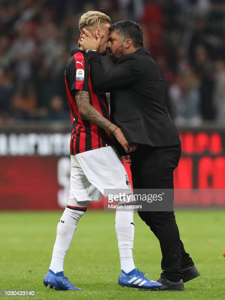 Milan coach Gennaro Gattuso celebrates a victory with Samuel Castillejo at the end of the serie A match between AC Milan and AS Roma at Stadio...